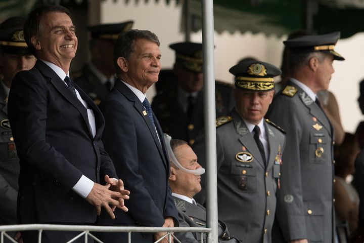 In this Dec. 1, 2018 photo, Jair Bolsonaro, left, and Minister of Defense Gen. Joaquim Silva e Luna attend a graduation ceremony at the Agulhas Negras Military Academy in Resende, Brazil.