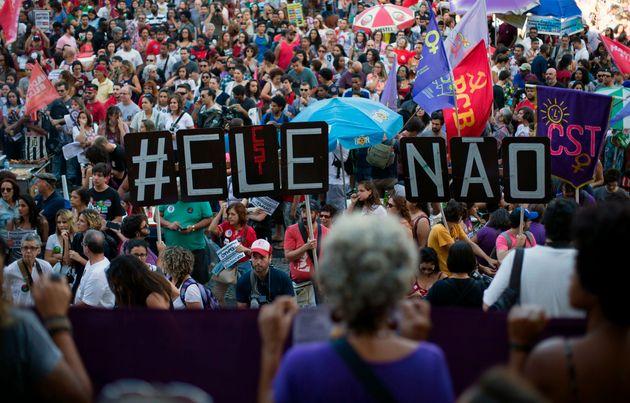 Demonstrators take part in a protestagainst Bolsonaro organized under the hashtag #EleNao (#NotHim),...