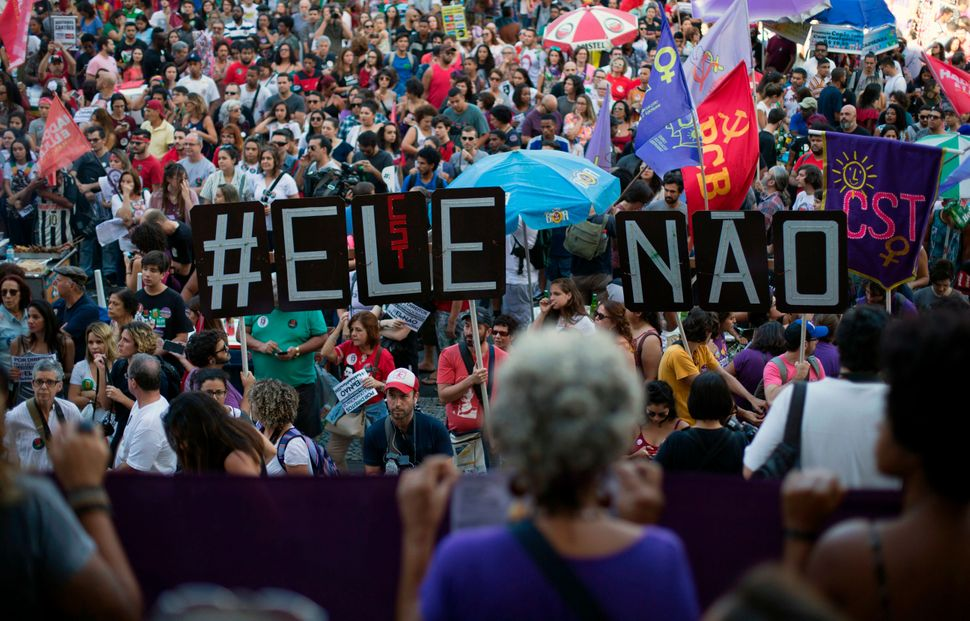 Demonstrators take part in a protest against Bolsonaro organized under the hashtag #EleNao (#NotHim), in Rio de Janeiro