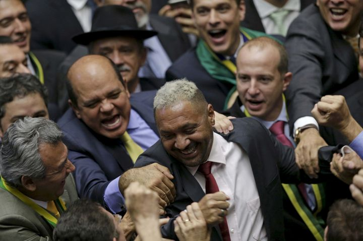 Tiririca,a Brazilian comedian and member of the Lower House of Congress, is congratulated after voting in favor of the impeachment of President Dilma Rousseff in Brasilia, on April 17, 2016.