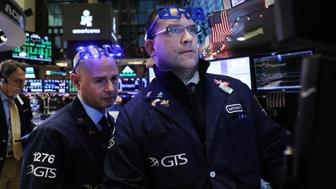 NEW YORK, NEW YORK - DECEMBER 31: Traders work on the floor of the New York Stock Exchange (NYSE) on the last day of the trading year on December 31, 2018 in New York City. Despite a continued strong economy and low unemployment, 2018 proved to be a volatile year in the financial markets with numerous record breaking trading sessions.The Dow finished up over 250 points on the final day of 2018.  (Photo by Spencer Platt/Getty Images)