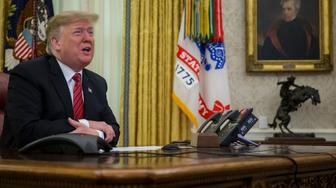 WASHINGTON, DC - DECEMBER 25:  U.S. President Donald Trump makes a video call to service members from the Army, Marine Corps, Navy, Air Force, and Coast Guard stationed worldwide in the Oval Office at the White House December 25, 2018 in Washington, DC.  (Photo by Zach Gibson-Pool/Getty Images)
