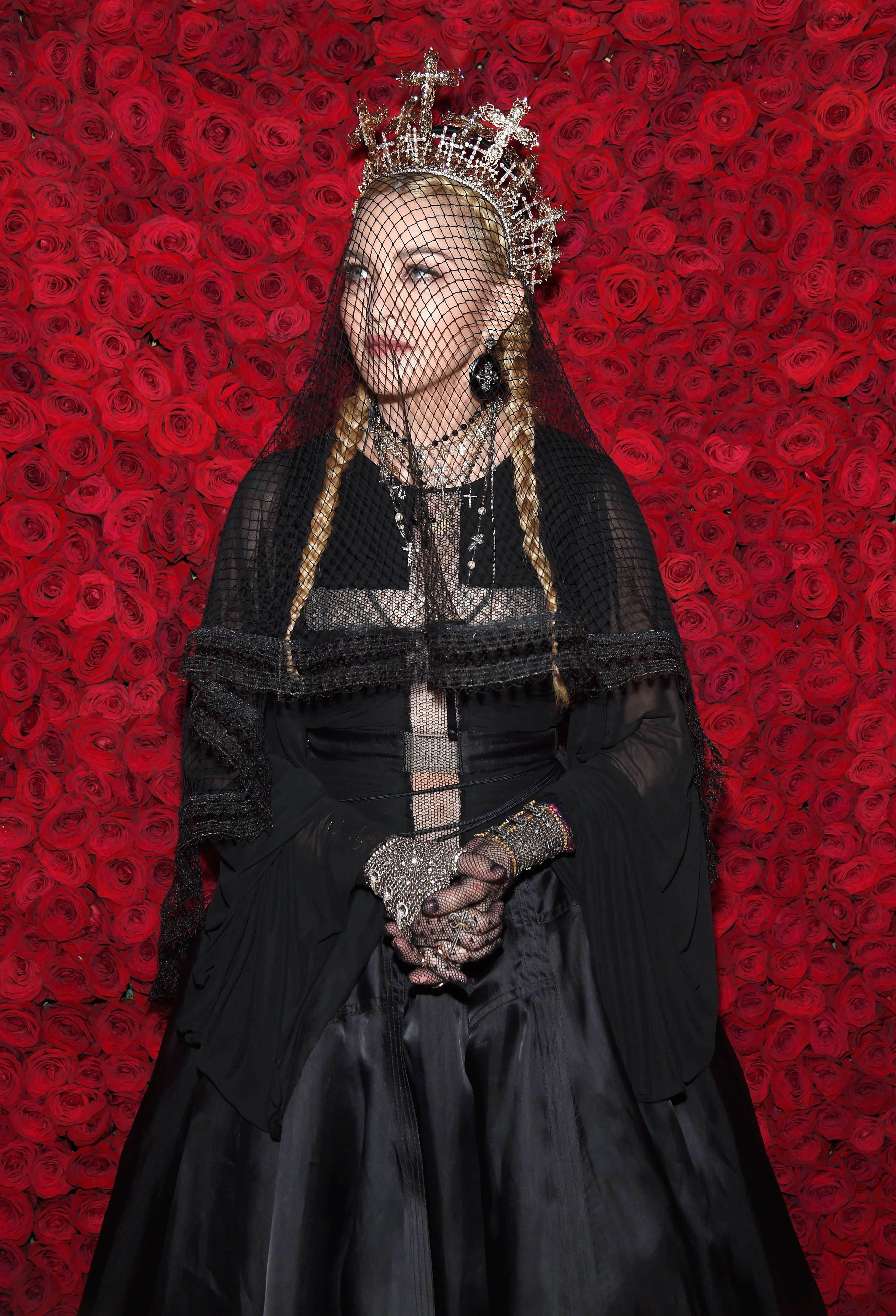 NEW YORK, NY - MAY 07:  Madonna attends the Heavenly Bodies: Fashion & The Catholic Imagination Costume Institute Gala at The Metropolitan Museum of Art on May 7, 2018 in New York City.  (Photo by Kevin Mazur/MG18/Getty Images for The Met Museum/Vogue)