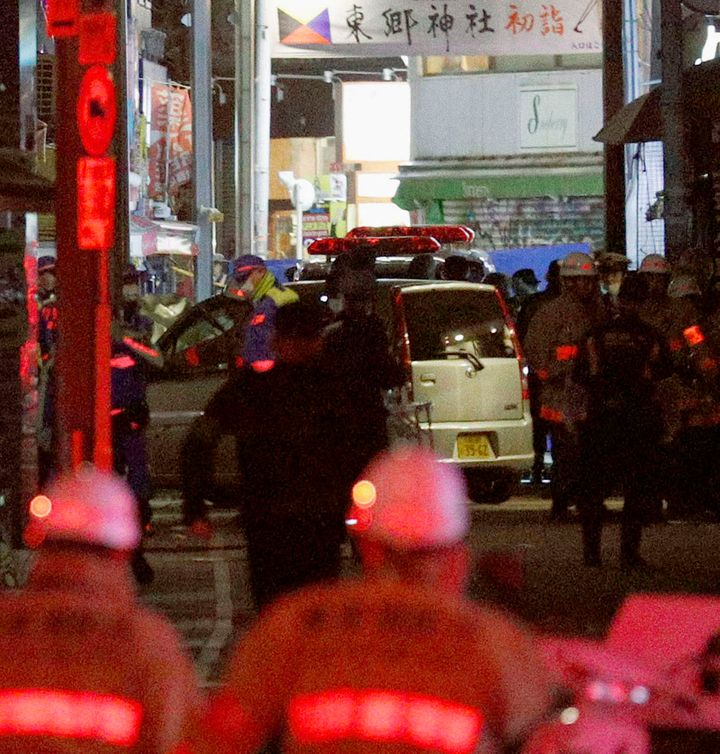 A car is inspected by police following a car attack on Takeshita Street in Tokyo, early Tuesday morning.