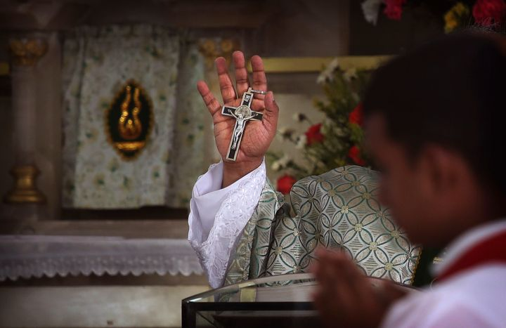 Catholic priest conducts Sunday mass at the Immaculate Heart of Mary Cathedral, in Kottayam, Kerala.