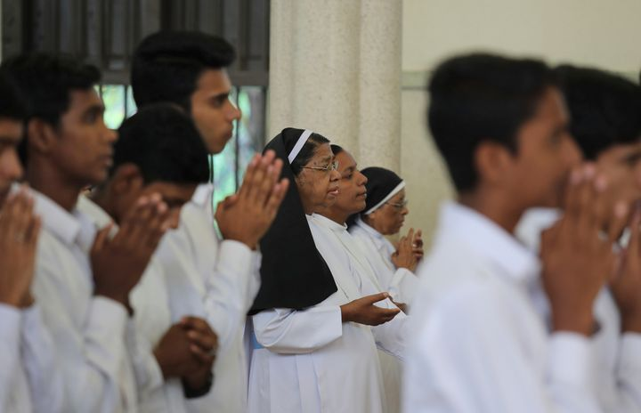 Senior nuns pray with others during Sunday mass at the Immaculate Heart of Mary Cathedral in Kottayam, Kerala.