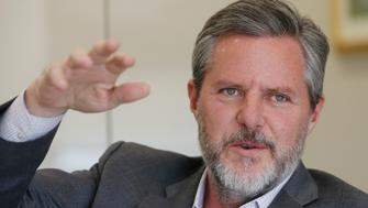 Liberty University president Jerry Falwell Jr., gestures during an interview in his offices at the school in Lynchburg, Va., Wednesday, Nov. 16, 2016. Liberty University, the world's largest Christian college and a mecca of conservative politics, students seem to be uniting after a divisive election that raised questions on campus about the college president's influence, open discourse, and practicality versus principles in choosing a candidate. (AP Photo/Steve Helber)