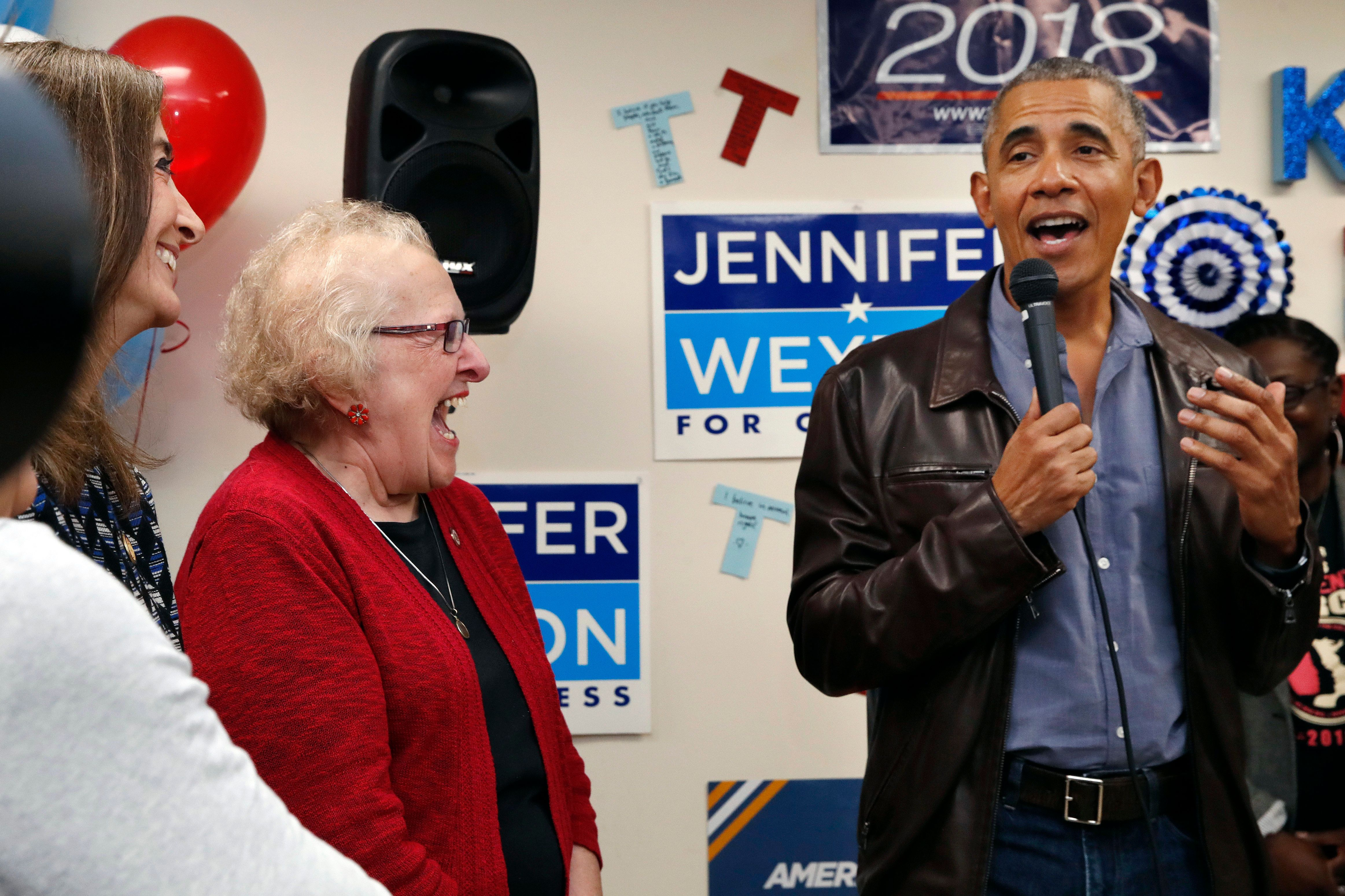 Democratic campaign volunteers react as former President Barack Obama, right, speaks during a surprise visit with Sen. Tim Kaine, D-Va., in Fairfax Station, Va., on Monday, Nov. 5, 2018. (AP Photo/Jacquelyn Martin)