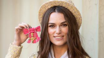 Keira Knightley shows her OBE after an Investiture ceremony at Buckingham Palace, London, Thursday Dec. 13, 2018. (Victoria Jones/Pool via AP)