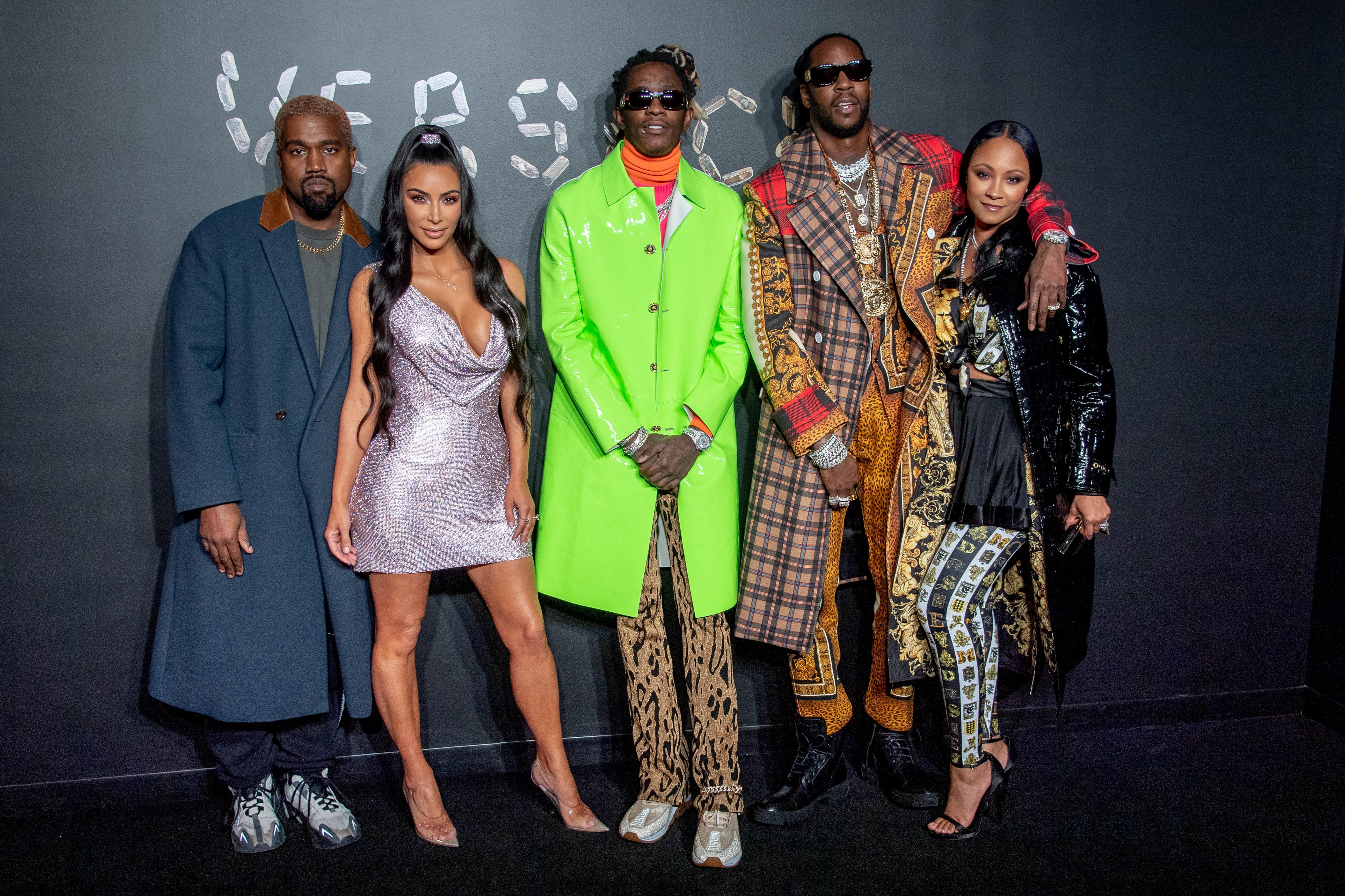 NEW YORK, NEW YORK - DECEMBER 02:  (L-R) Kanye West, Kim Kardashian West, Young Thug, 2 Chainz and Kesha Ward attend the the Versace fall 2019 fashion show at the American Stock Exchange Building in lower Manhattan on December 02, 2018 in New York City. (Photo by Roy Rochlin/Getty Images)
