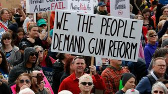 Thousands of protesters flood the Utah State Capitol on Saturday, March 24, 2018, in Salt Lake City, seeking stronger gun-control measures in response to last month's school shooting in Parkland, Fla. (AP Photo/Rick Bowmer)