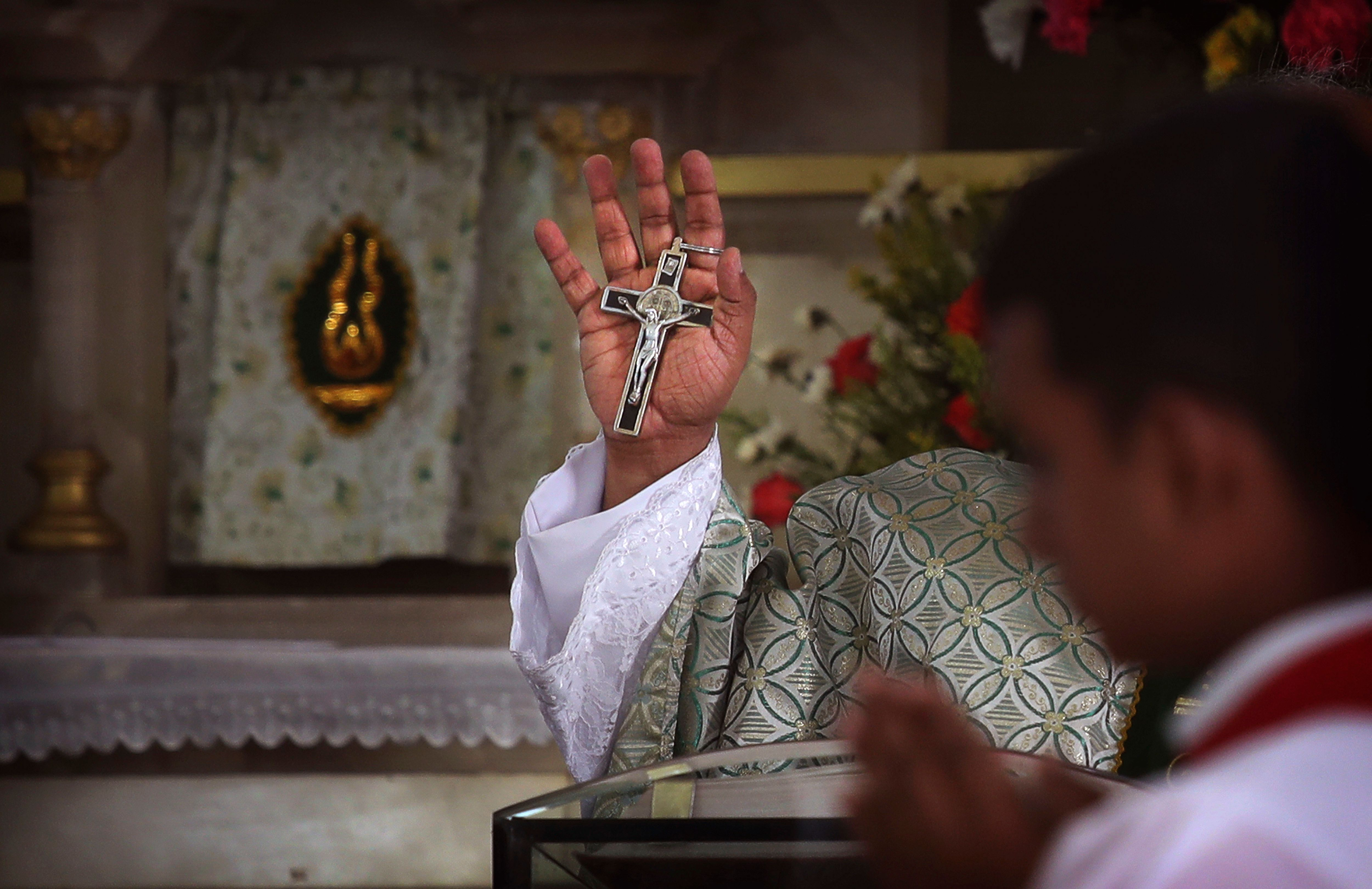 In this Sunday, Nov. 4, 2018, photo, a Catholic priest conducts Sunday mass at the Immaculate Heart of Mary Cathedral, in Kottayam in the southern Indian state of Kerala. An AP investigation has uncovered a decades-long history of nuns in India enduring sexual abuse from within the Catholic church. (AP Photo/Manish Swarup)