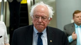 Sen. Bernie Sanders, I-Vt., heads to his office, as the Senate takes up a House-passed bill that would pay for President Donald Trump's border wall and avert a partial government shutdown, at the Capitol in Washington, Friday, Dec. 21, 2018. (AP Photo/Jose Luis Magana)