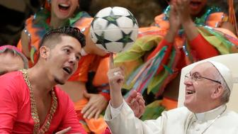 Pope Francis twirls a soccer ball he was presented by a member of the Circus of Cuba, during his weekly general audience in the Pope Paul VI hall, at the Vatican, Wednesday, Jan. 2, 2019. (AP Photo/Andrew Medichini)