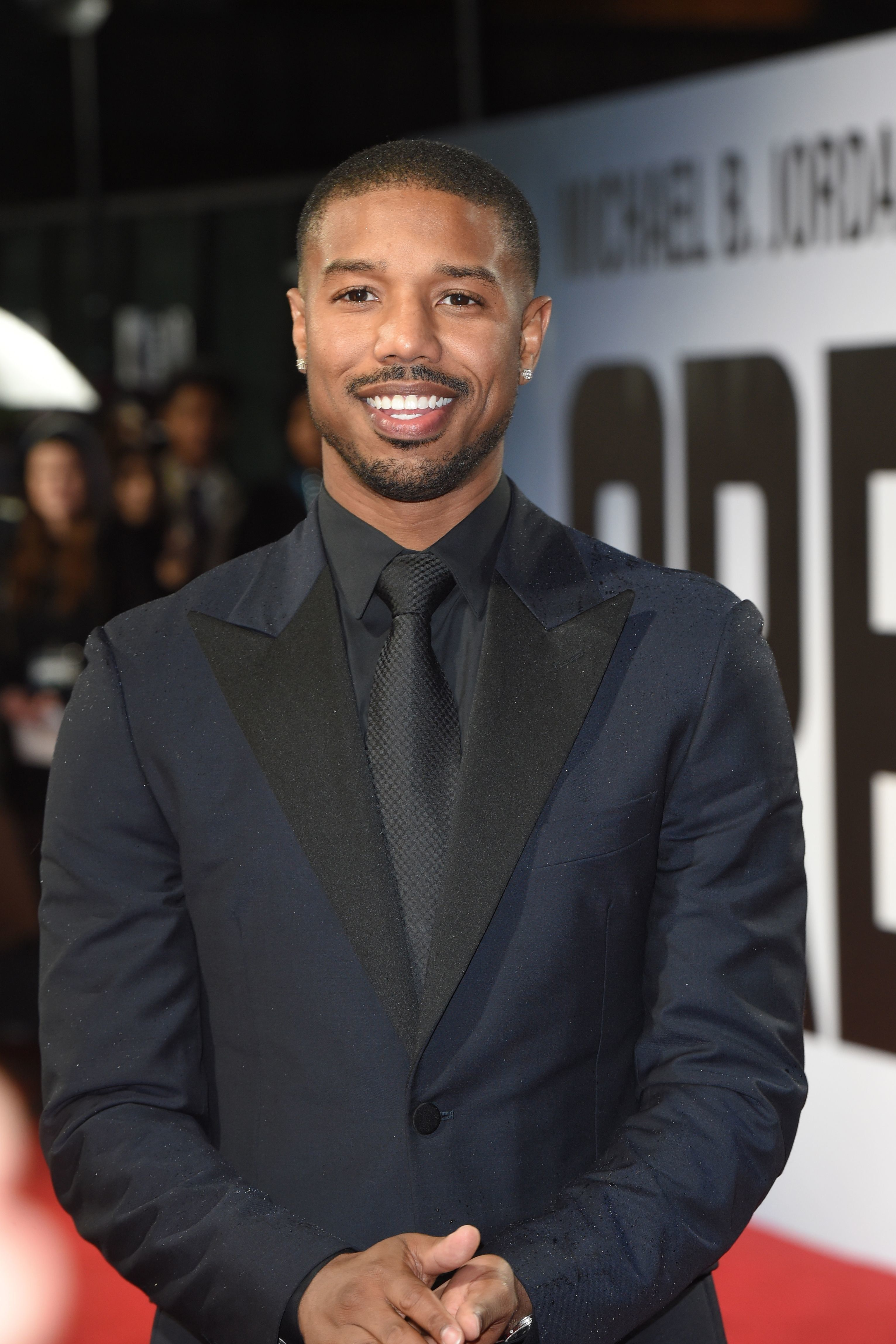 US actor Michael B Jordan poses upon arrival to attend the European Premiere of the film 'Creed II' in London on November 28, 2018. (Photo by Anthony HARVEY / AFP)        (Photo credit should read ANTHONY HARVEY/AFP/Getty Images)