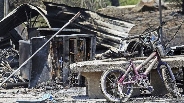 A home in El Jebel, Colorado, sits in ruins after being destroyed by a wildfire this summer. About half the state's residents