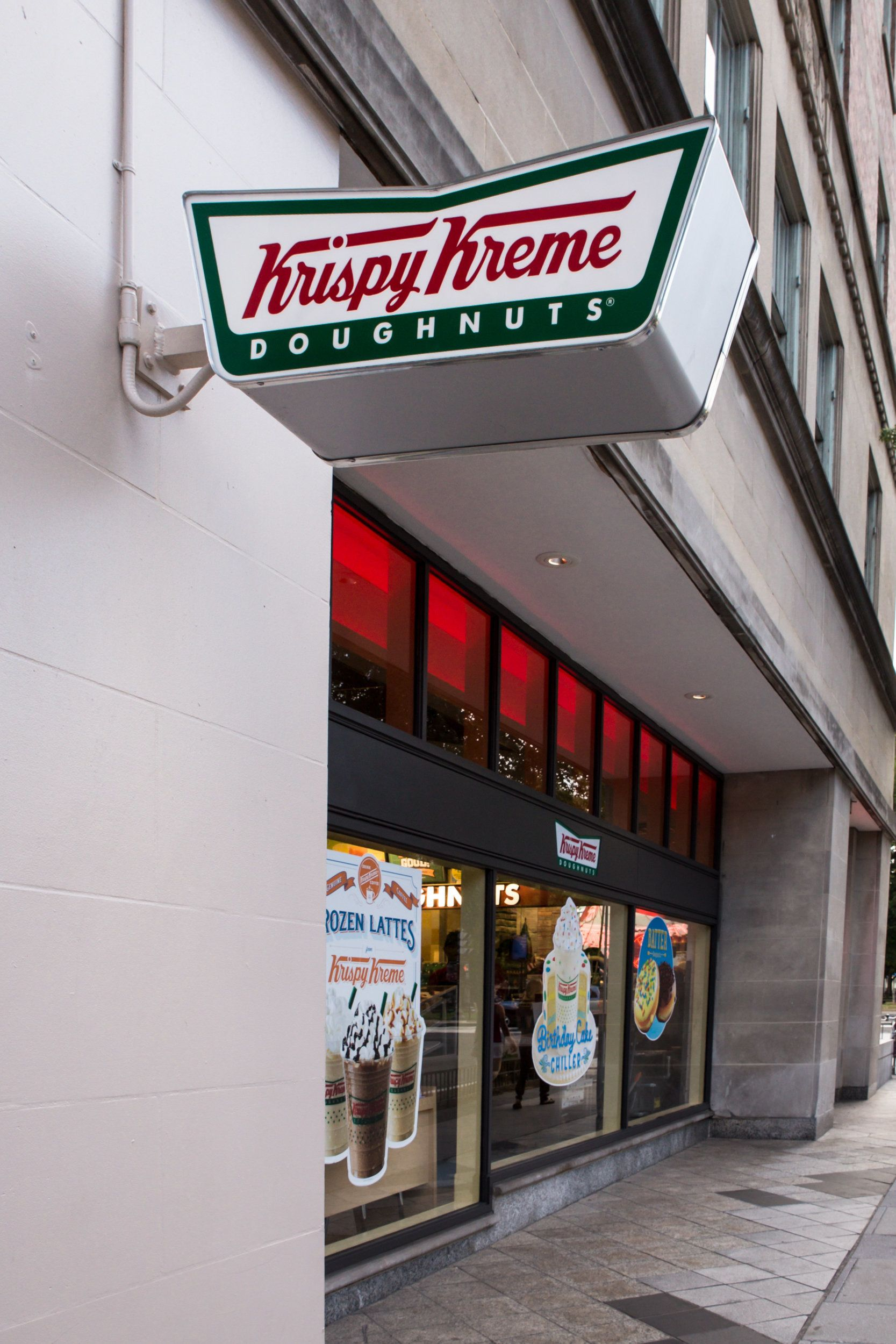 Washington DC, United States - August 8, 2015: View of the Krispy Kreme Doughnut storefront in Washington DC at Dupont Circle. Krispy Kreme Doughnuts, Inc. is a popular American global doughnut company and coffeehouse chain founded by   Vernon Rudolph