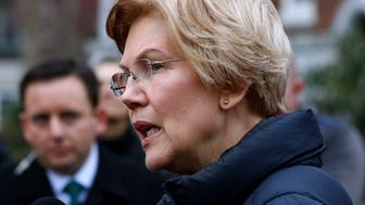 Sen. Elizabeth Warren, D-Mass., speaks outside her home, Monday, Dec. 31, 2018, in Cambridge, Mass. Warren on Monday took the first major step toward launching a widely anticipated campaign for the presidency, hoping her reputation as a populist fighter can help her navigate a Democratic field that could include nearly two dozen candidates. (AP Photo/Bill Sikes)