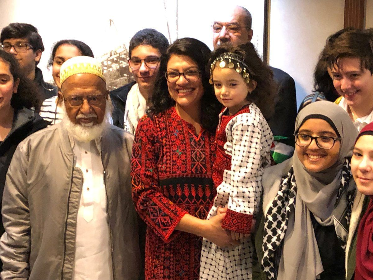 Congresswoman Rashida Tlaib (D-MI), the first Palestinian-American elected to the House, poses with supporters outside her office at the Longworth House Office Building (LHOB), in Washington, D.C., U.S., January 3, 2019 in this image obtained from social media. Adam Shapiro via REUTERS  ATTENTION EDITORS - THIS IMAGE WAS PROVIDED BY A THIRD PARTY. MANDATORY CREDIT.