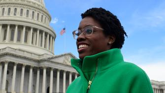 Rep.-elect Lauren Underwood, D-Ill., walks outside following a photo opportunity on Capitol Hill in Washington, Wednesday, Nov. 14, 2018, with the freshman class. (AP Photo/Susan Walsh)