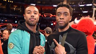 LOS ANGELES, CA - FEBRUARY 17:  Michael B. Jordan and Chadwick Boseman attend the 2018 State Farm All-Star Saturday Night at Staples Center on February 17, 2018 in Los Angeles, California.  (Photo by Kevin Mazur/WireImage)