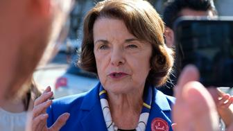 U.S. Sen. Dianne Feinstein talks with reporters after dropping off her vote-by-mail ballot outside City Hall Monday, Nov. 5, 2018, in San Francisco. Feinstein, who is seeking her fifth full term in the Senate, is being challenged by fellow Democrat, state Sen. Kevin de Leon. (AP Photo/Eric Risberg)