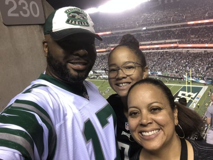 Koroun Butler, with his daughter, Naomi, and wife, Danielle, at a Philadelphia Eagles game.