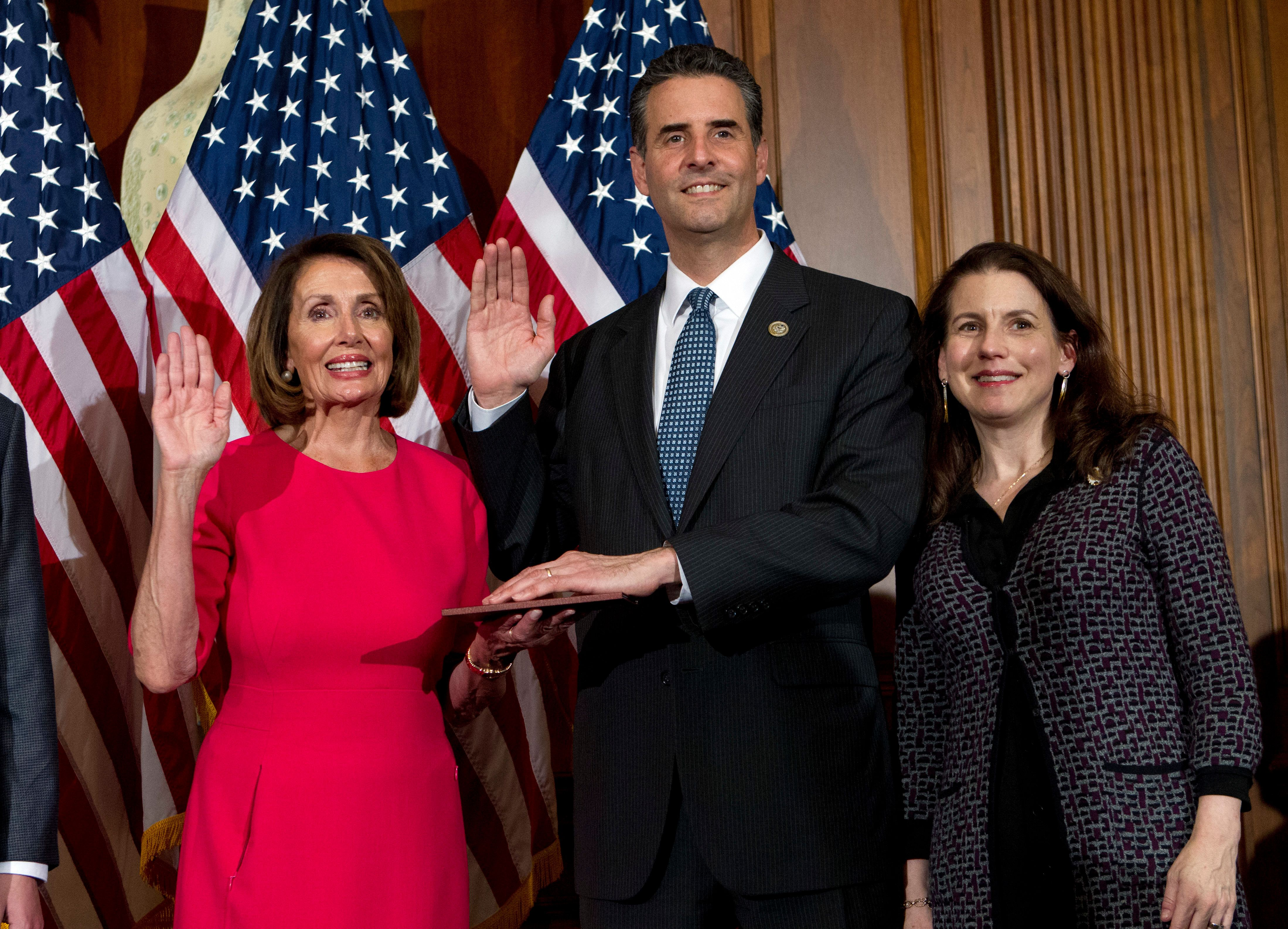 House Speaker Nancy Pelosi of Calif., administers the House oath of office to Rep. John Sarbanes, D-Md., during ceremonial swearing-in on Capitol Hill in Washington, Thursday, Jan. 3, 2019, during the opening session of the 116th Congress. (AP Photo/Jose Luis Magana)