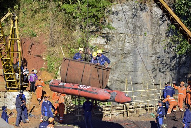 Navy personnel come out of a coal mine during a rescue operation in Ksan,