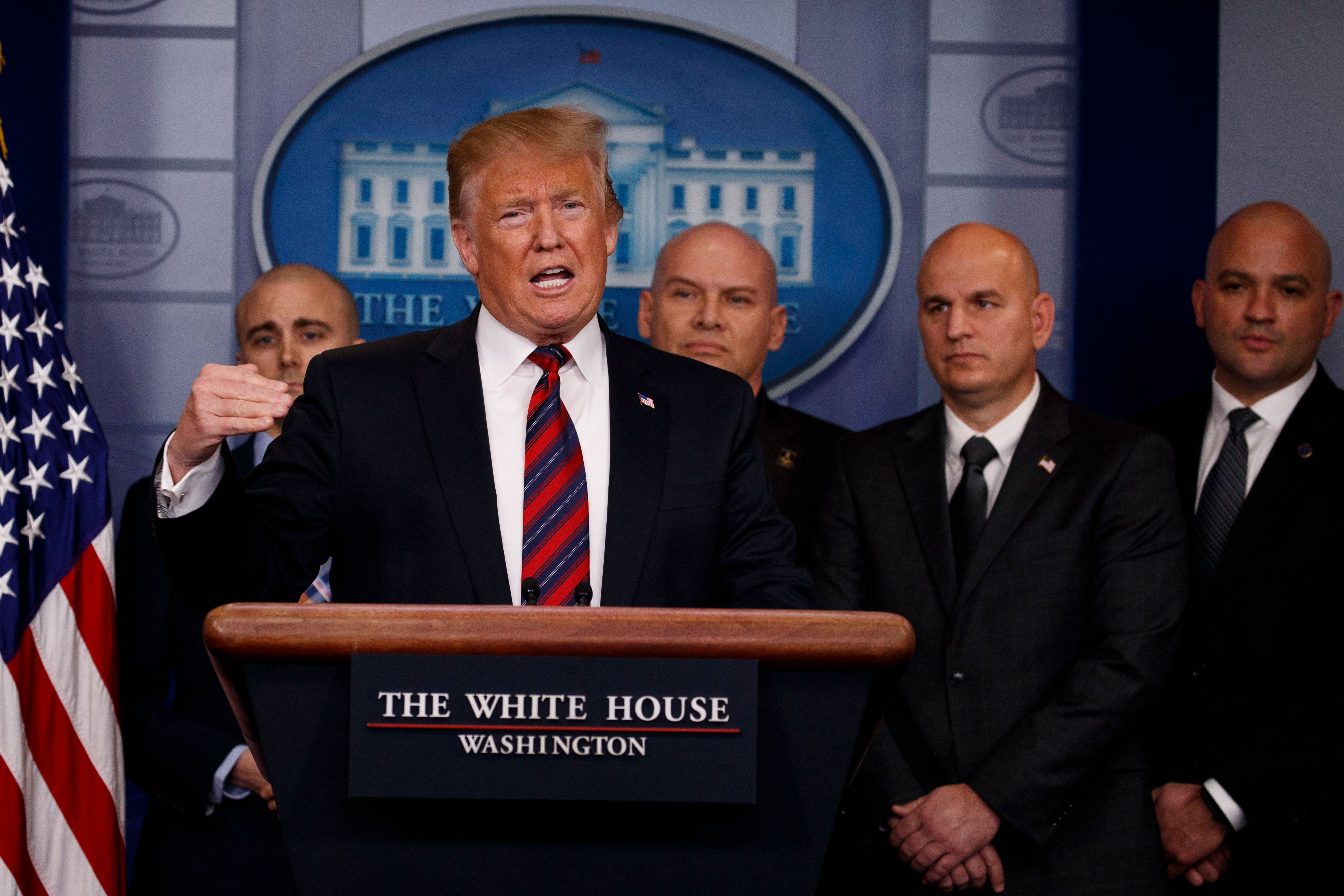 Trump Mocked For Holding Press Conference Flanked By Four Bald White