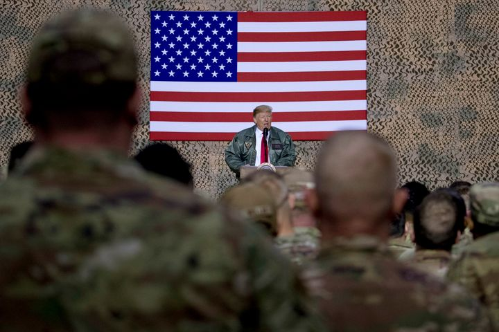 President Trump speaks to troops in Afghanistan on Dec. 26.