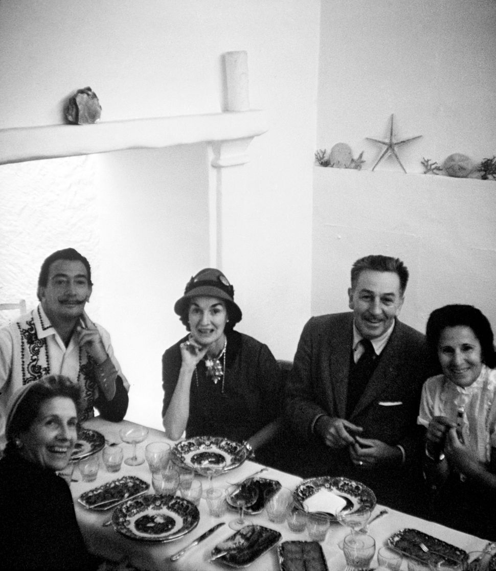 The Dalí and Disney families around the dinner table in Spain, 1957 Photograph Courtesy of The Walt Disney Company, © Disney.