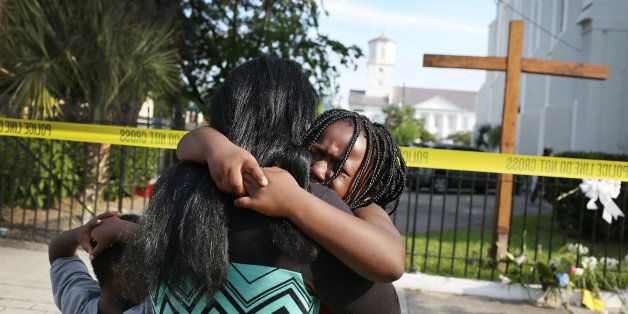 CHARLESTON, SC - JUNE 19: Kearston Farr comforts her daughter, Taliyah Farr,5, as they stand in front of the Emanuel African