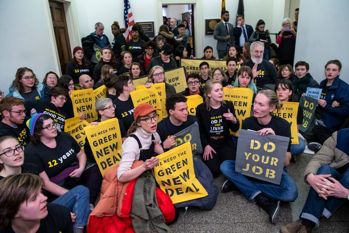 Protesters with the Sunrise Movement stage a sit-in in the office of Rep. Steny Hoyer, now the House majority leader, late last year to demand a Green New Deal.