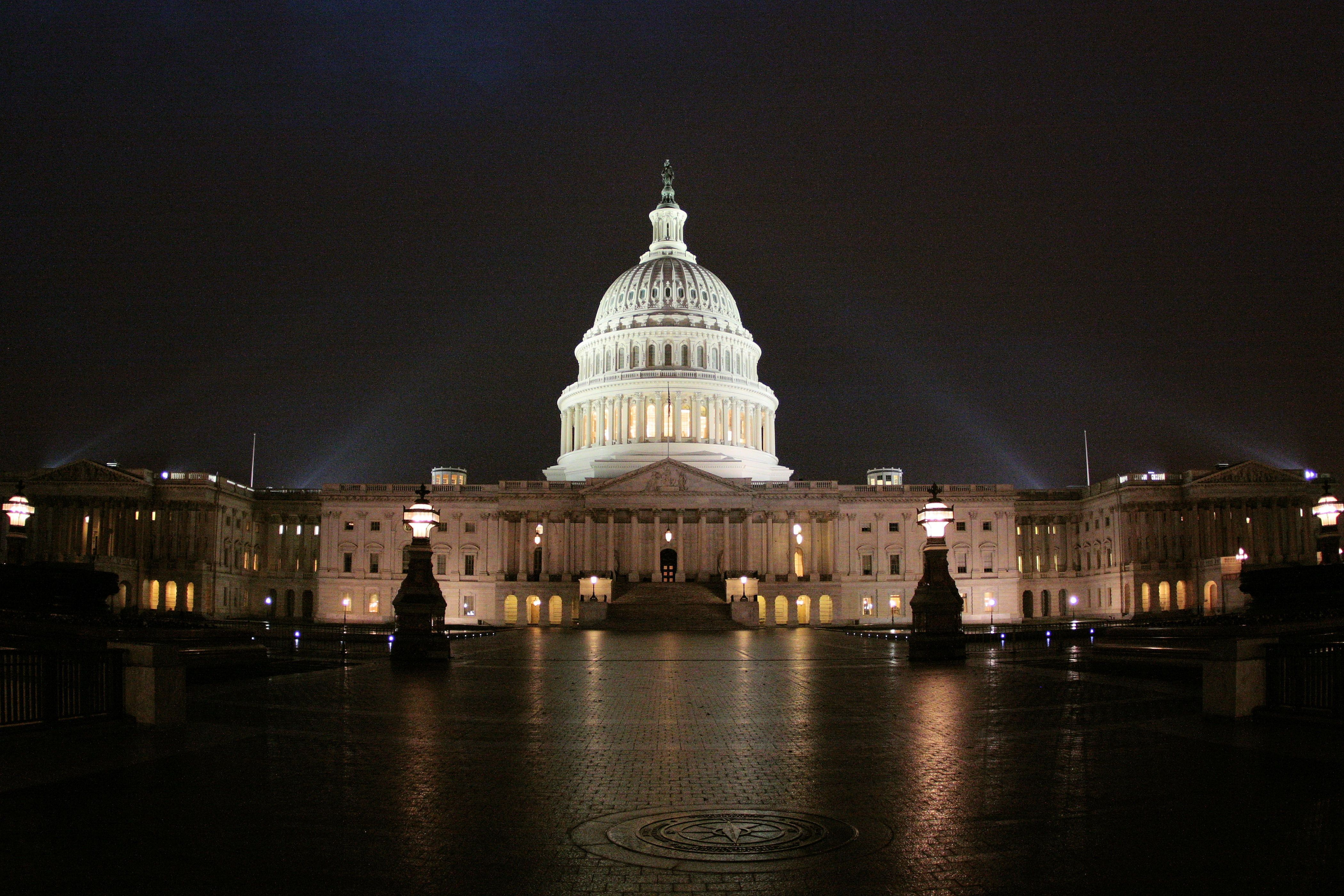The dome of the United States Capitol lit at night in Washington, DC.