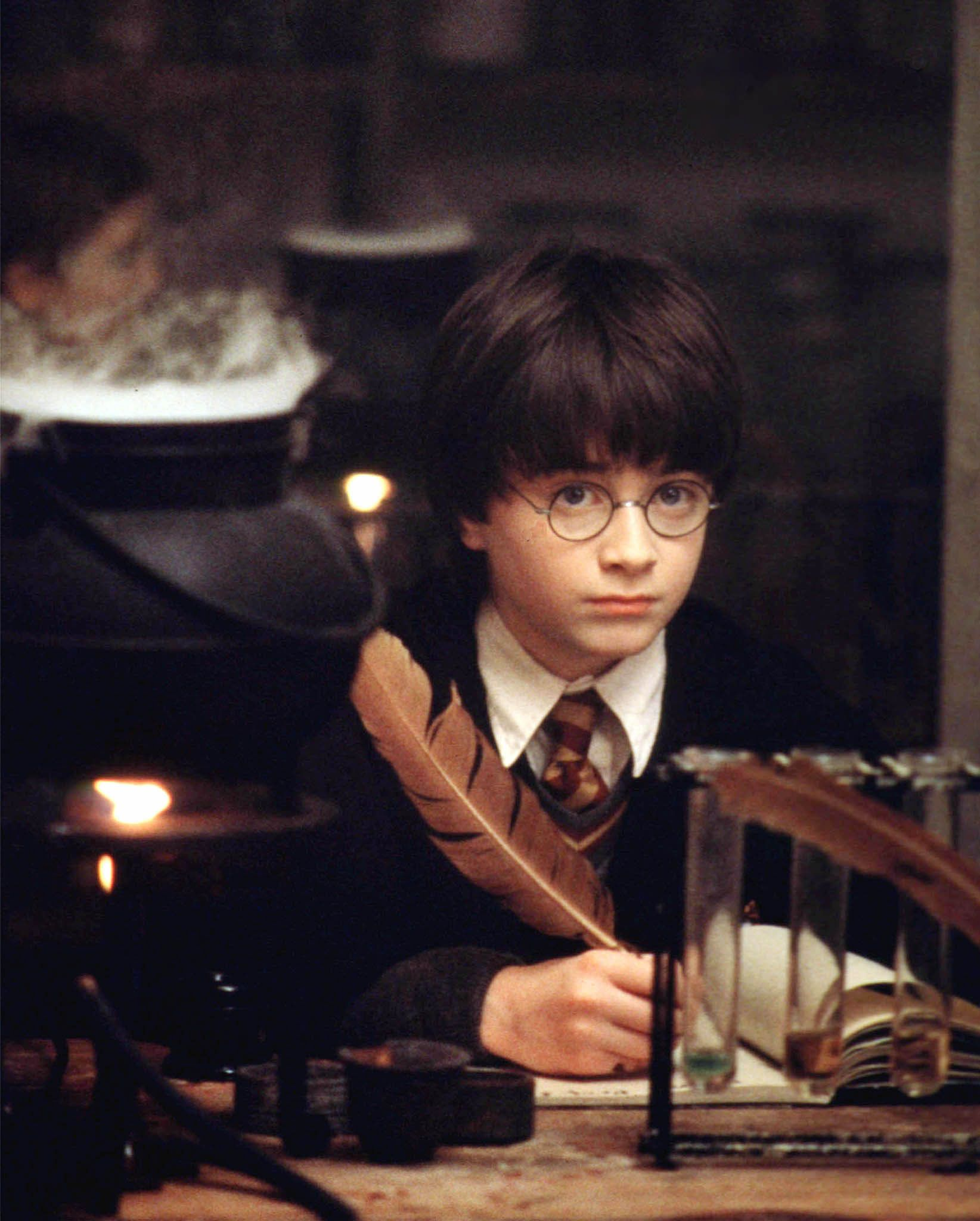 "Actor Daniel Radcliffe is pictured as the title character in Warner Bros. new film ""Harry Potter and the Sorcerer's Stone"" which makes its world debut in London on November 4, 2001. The film, which is called ""Harry Potter and the Philosopher's Stone"" in the UK, is based on the book by British author J.K. Rowling.   (CREDIT REUTERS/Peter Mountain/Warner Bros.)"