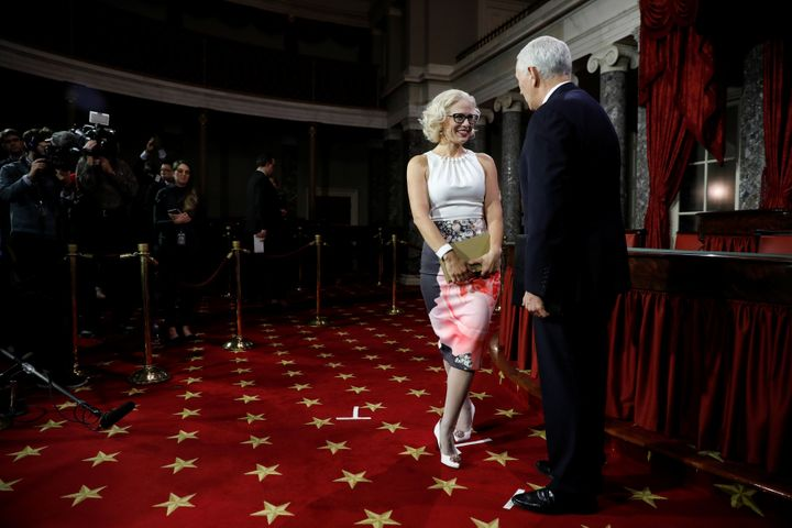 Sinema showed up in a high femme look for her first day in the Senate.