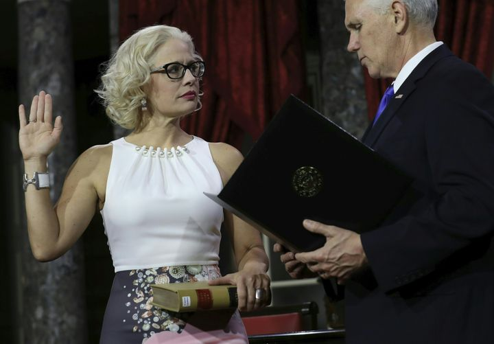 Sen. Kyrsten Sinema (D-Ariz.) participates in a ceremonial swearing-in on January 3, 2019. Rather than use a traditional Bibl