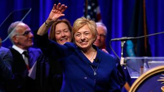 Gov. Janet Mills acknowledges applause after taking the oath of office, Wednesday, Jan. 2, 2019, at the Augusta Civic Center in Augusta, Maine. Mills, a Democrat, is the state's first female governor. (AP Photo/Robert F. Bukaty)