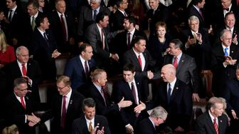 Republican members congratulate each other after being sworn-in in the House of Representatives during the opening session of the 116th Congress on Capitol Hill January 3, 2019 in Washington, DC. (Photo by Brendan Smialowski / AFP)        (Photo credit should read BRENDAN SMIALOWSKI/AFP/Getty Images)
