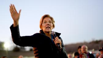 Sen. Elizabeth Warren, D-Mass, addresses an overflow crowd outside an organizing event at McCoy's Bar Patio and Grill in Council Bluffs, Iowa, Friday, Jan. 4, 2019. Warren is making her first visit to Iowa this weekend as a likely presidential candidate, testing how her brand of fiery liberalism plays in the nation's premier caucus state. (AP Photo/Nati Harnik)
