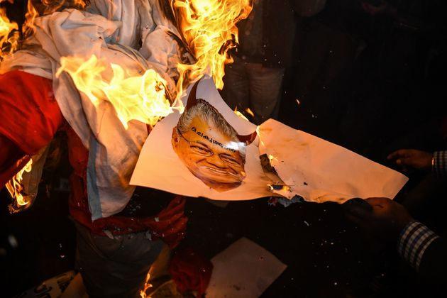 Right wing activists burn effigy of Chief Minister of Kerala Pinarayi Vijayan during a demonstration...