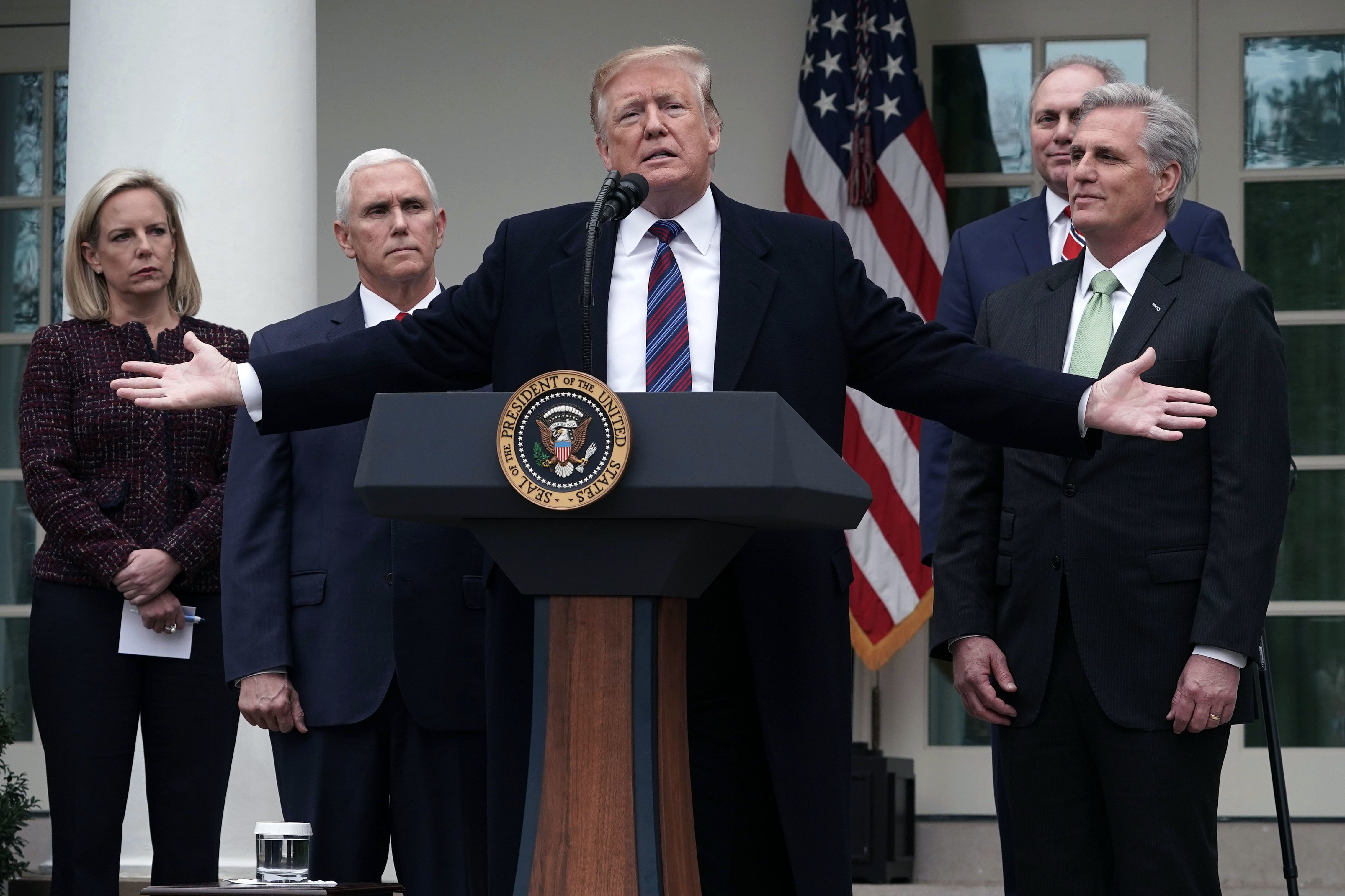 WASHINGTON, DC - JANUARY 04:  U.S. President Donald Trump (3rd L) speaks as Secretary of Homeland Security Kirstjen Nielsen (L), Vice President Mike Pence (2nd L), House Minority Whip Rep. Steve Scalise (R-LA) (4th L) and House Minority Leader Rep. Kevin McCarthy (R-CA) (R) listen in the Rose Garden of the White House on January 4, 2019 in Washington, DC. Trump hosted both Democratic and Republican lawmakers at the White House for the second meeting in three days as the government shutdown heads into its third week.  (Photo by Alex Wong/Getty Images)