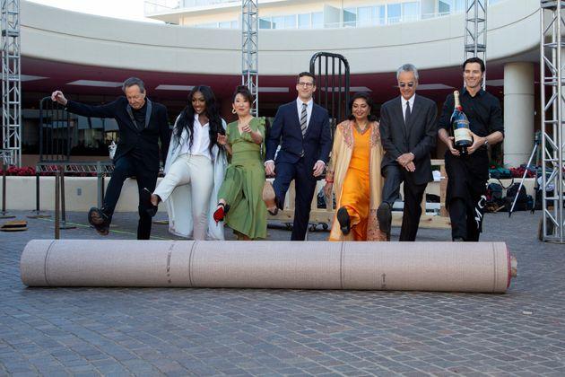Barry Adelman, from left, Isan Elba, Sandra Oh, Andy Samberg, Meher Tatna and Allen Shapiro roll-up the...