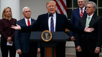 President Donald Trump speaks in the Rose Garden of the White House in Washington, after a meeting with Congressional leaders on border security, as the government shutdown continues Friday, Jan. 4, 2019, as Homeland Security Secretary Kirstjen Nielsen, Vice President Mike Pence, House Minority Whip Steve Scalise of La., and House Minority Leader Kevin McCarthy of Calif., listen. (AP Photo/ Manuel Balce Ceneta)