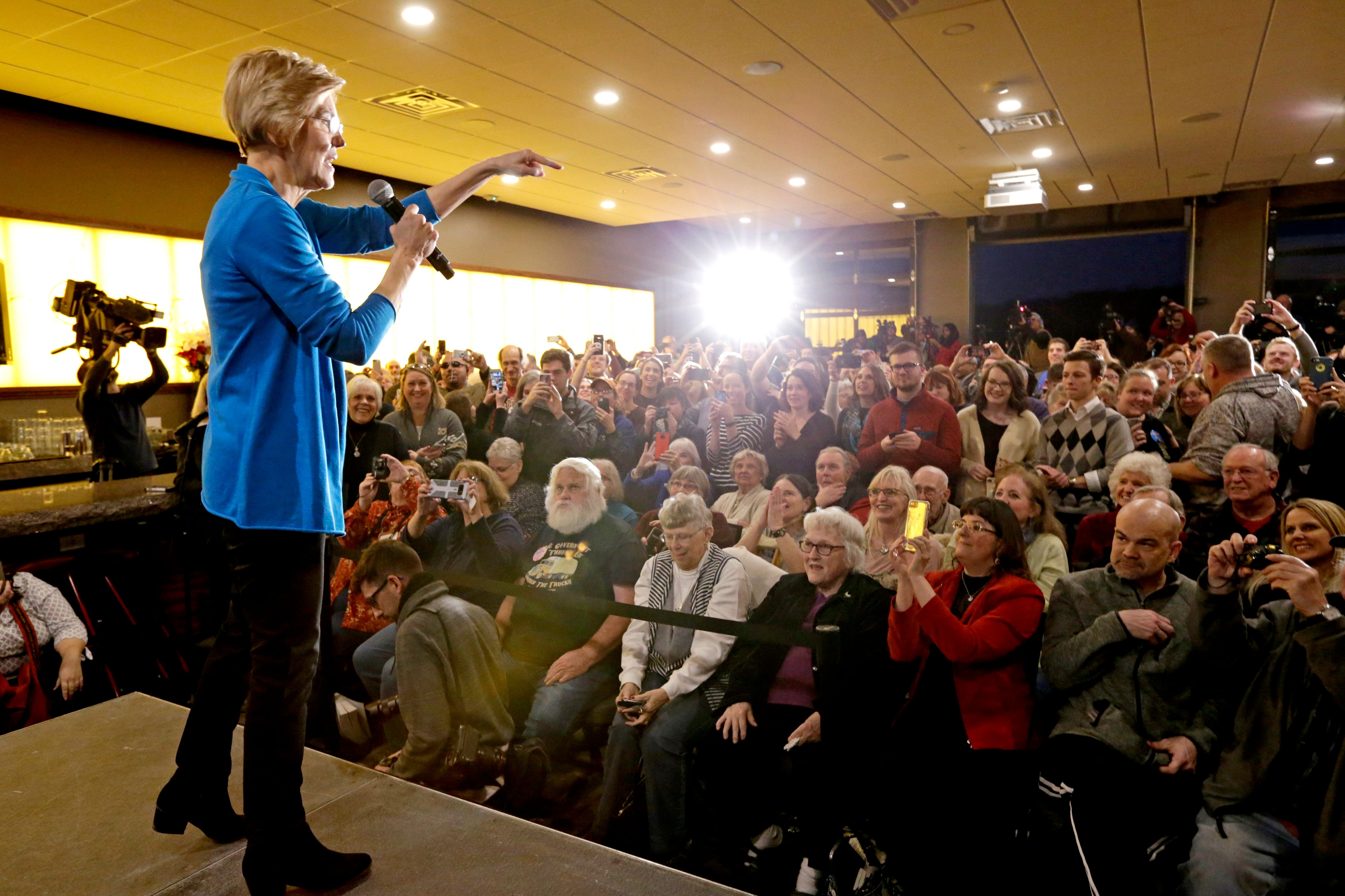 Sen. Elizabeth Warren, D-Mass, addresses the crowd at an organizing event at McCoy's Bar Patio and Grill in Council Bluffs, Iowa, Friday, Jan. 4, 2019. Warren is making her first visit to Iowa this weekend as a likely presidential candidate, testing how her brand of fiery liberalism plays in the nation's premier caucus state. (AP Photo/Nati Harnik)