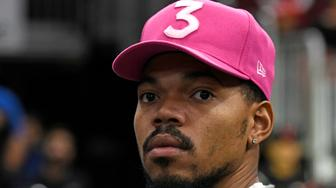Chance the Rapper watches warmups before an NBA basketball game between the Chicago Bulls and the San Antonio Spurs Monday, Nov. 26, 2018, in Chicago. (AP Photo/David Banks)