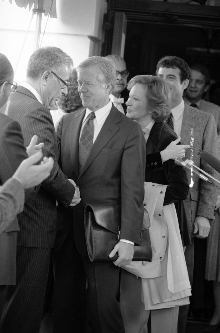 President Jimmy Carter shaking hands with Defense Secretary Harold Brown in 1980.