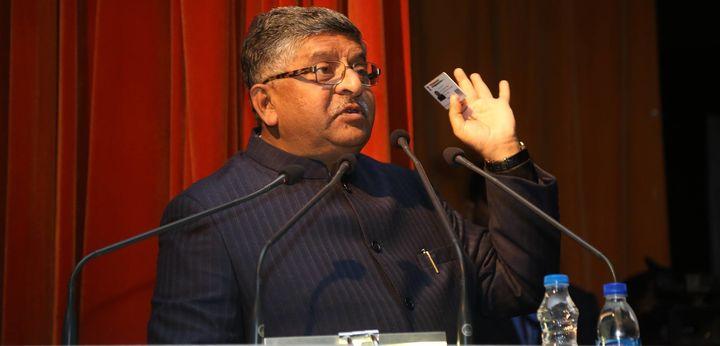 Union IT Minister Ravi Shankar Prasad flashing his Aadhaar at the Indian Science Congress on Saturday