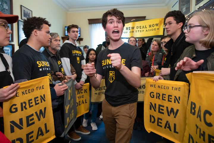 Jeremy Ornstein of Watertown, Massachusetts, cheers on fellow environmental activists as they occupy the office of Rep. Steny